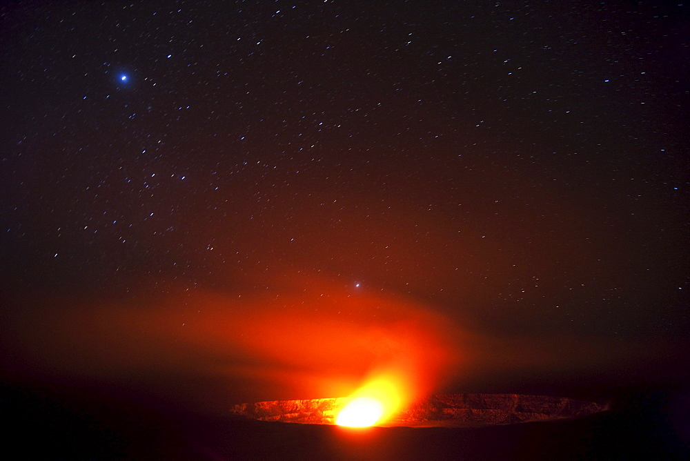 Hawaii, United States Of America; Halema'uma'u Vent Inside Kilauea Crater Glows From Molten Lava At Night With Star Field In The Sky