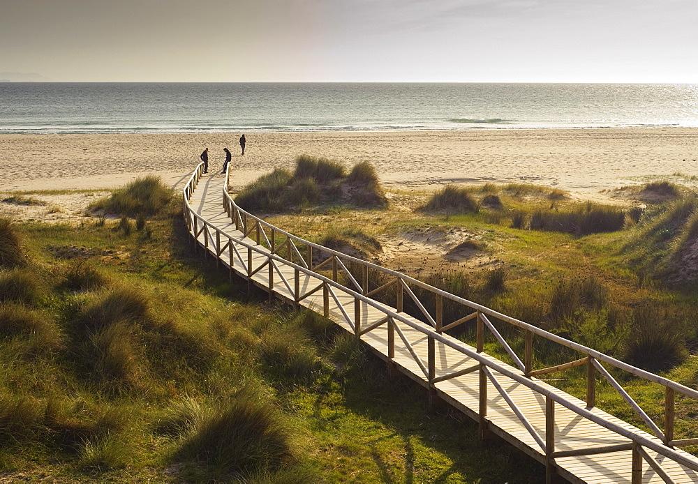 Tarifa, Costa De La Luz, Cadiz, Andalusia, Spain; A Wooden Boardwalk Leading To Dos Mares Beach In Front Of Hotel Dos Mares