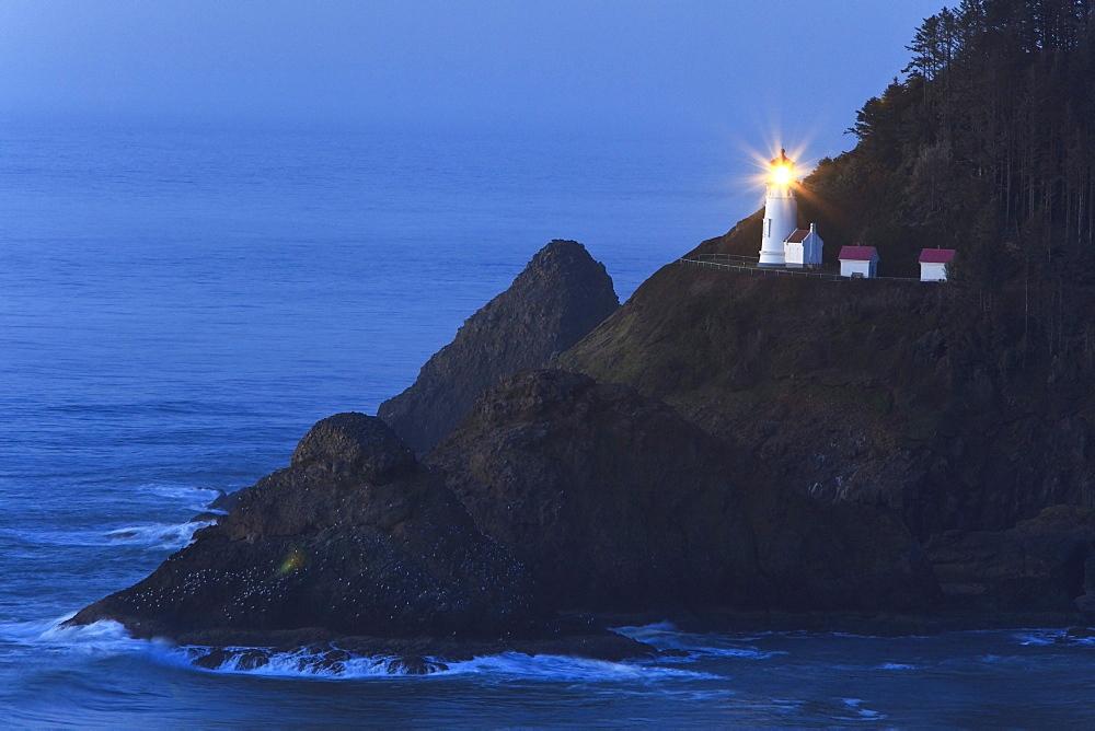 Oregon, United States Of America; Heceta Head Lighthouse At Sunset