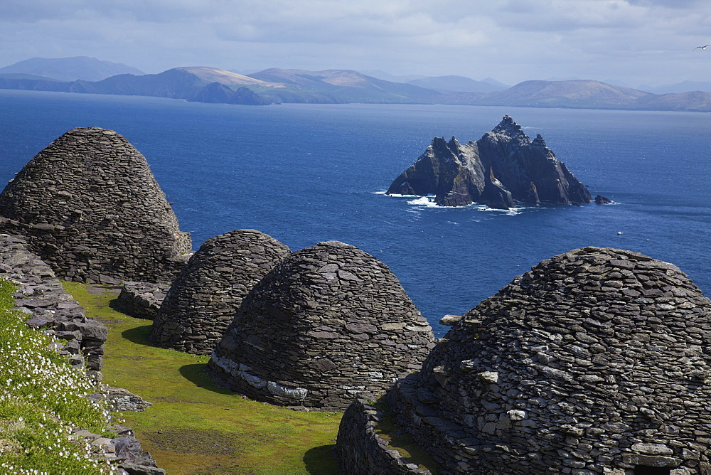 Skellig Michael, County Kerry, Ireland; Stone 'beehive' Monk Huts (Clochans) With A View Of Skellig Beag