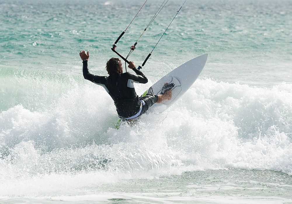 A Man Kitesurfing At Punta Paloma Beach; Tarifa, Cadiz, Andalusia, Spain