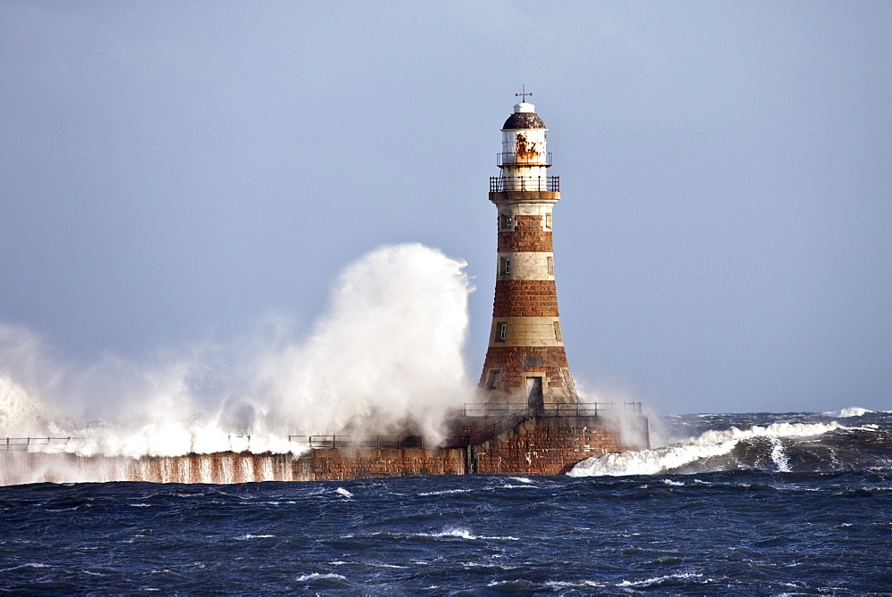 Waves Crashing Against Roker Lighthouse; Sunderland, Tyne And Wear, England
