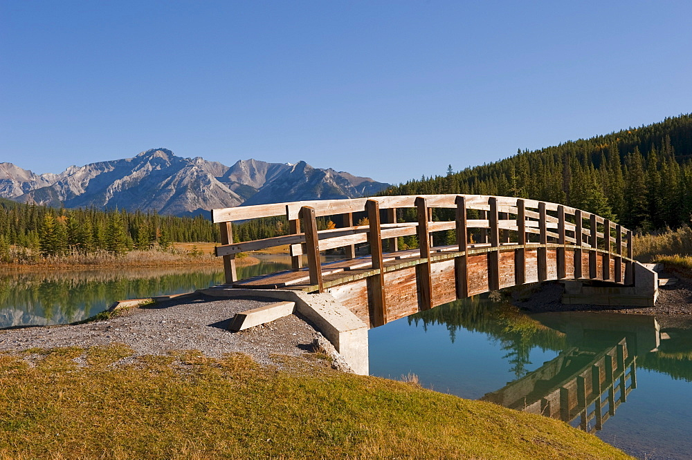 Footbridge At Cascade Ponds In Banff National Park; Banff, Alberta, Canada