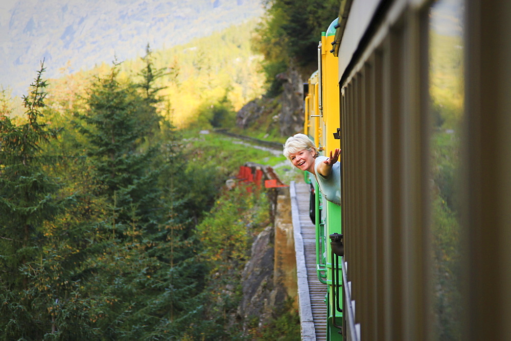 Middle-Aged Woman On White Pass & Yukon Route Train; Skagway, Alaska