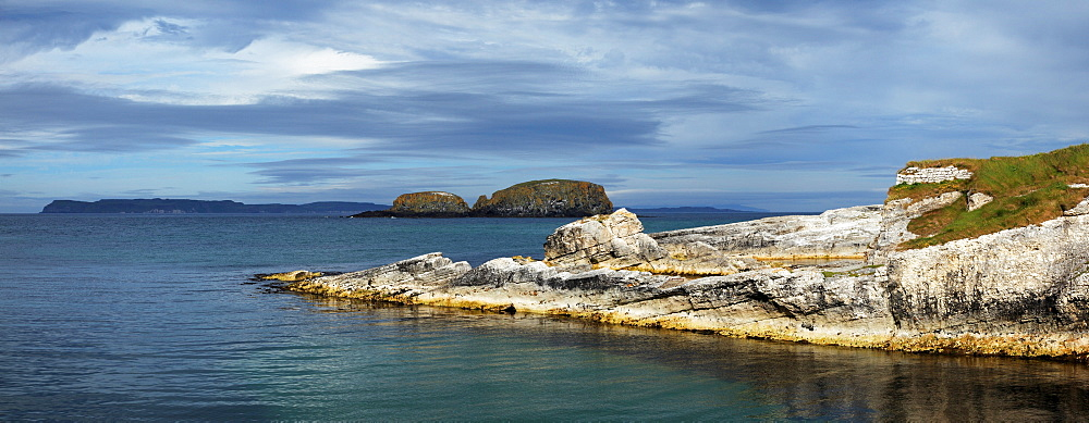 Ballintoy Harbour With Rathlin Island In The Distance; Ballintoy, County Antrim, Northern Ireland