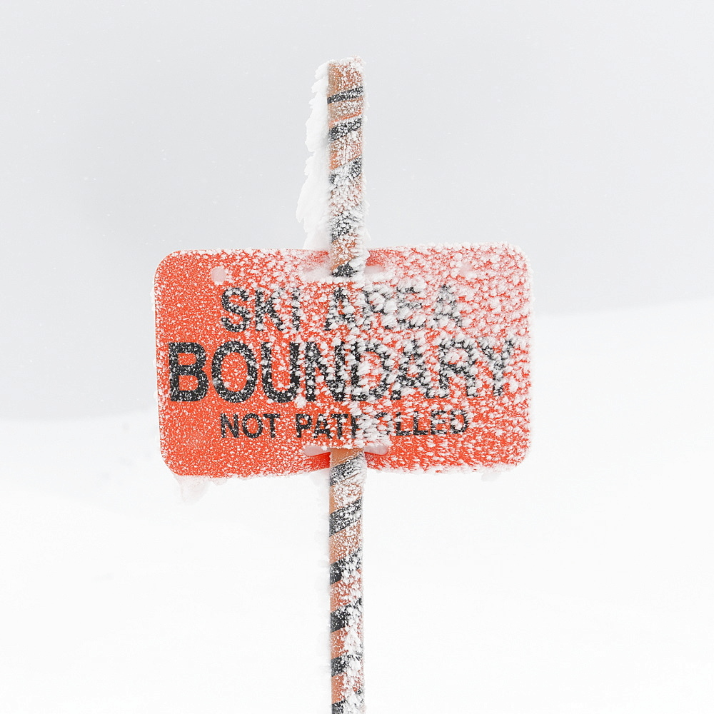 Snow Covering A Ski Area Boundary Sign, Whistler, British Columbia, Canada