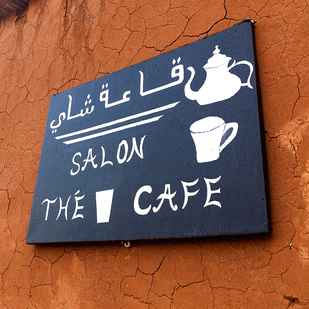 A bilingual sign for a cafe - 1116-41663