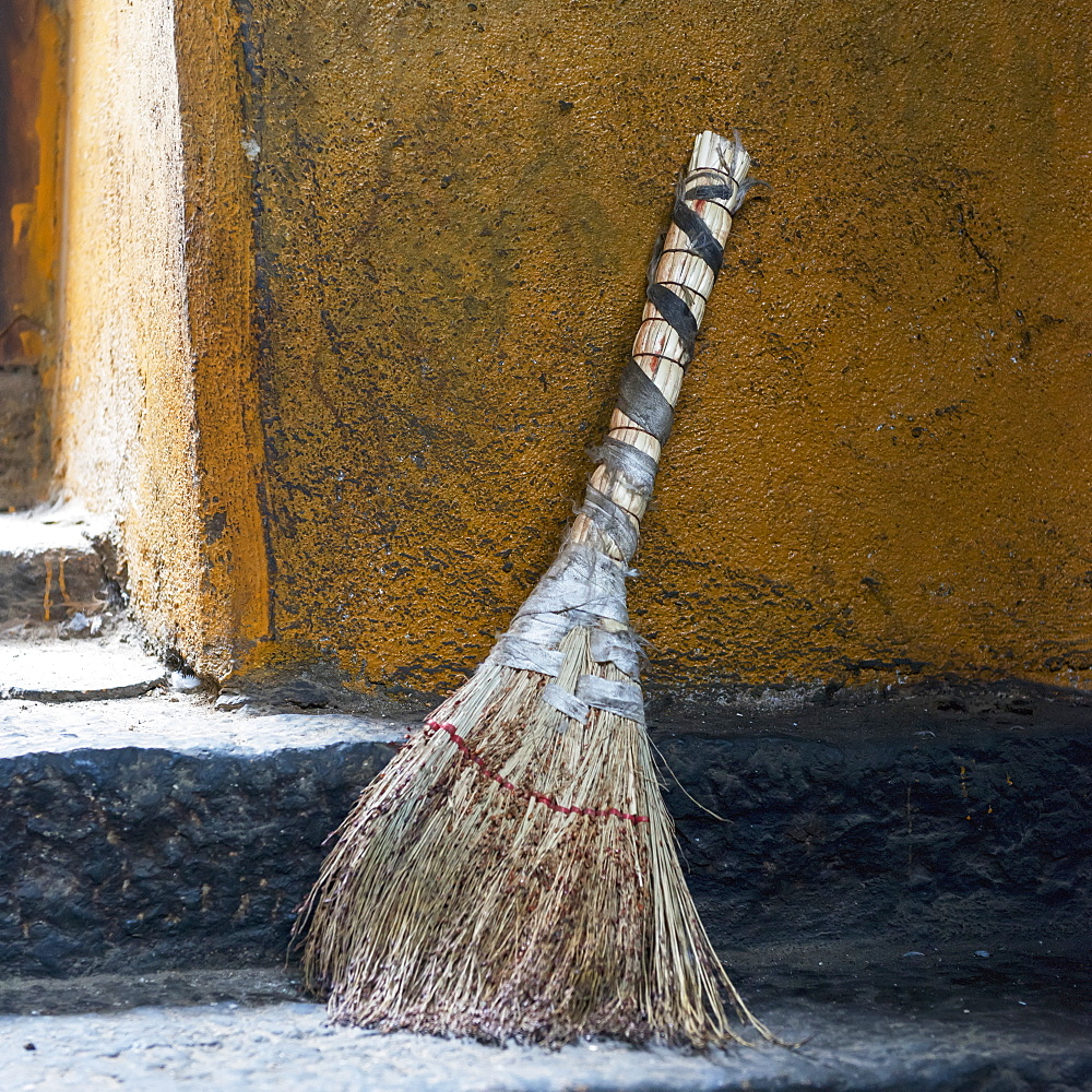 A broom sitting outside a doorway, Lhasa xizang china