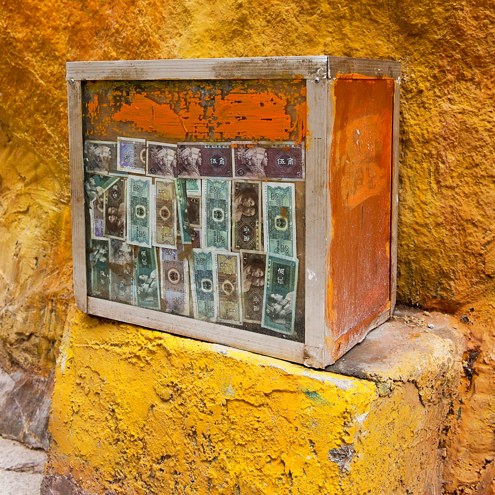 Currency attached to a weathered wooden crate at drepung monastery, Lhasa xizang china