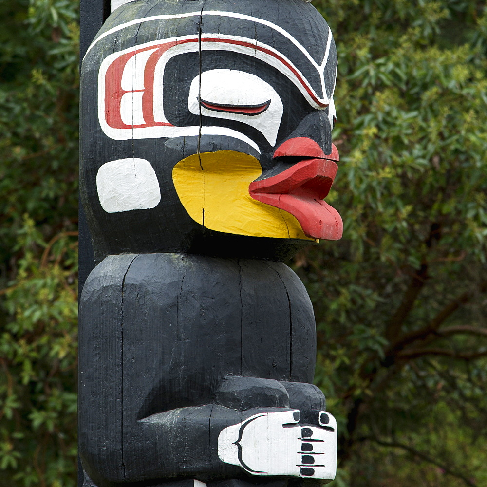Totem Pole Painted In Colour, Vancouver, British Columbia, Canada