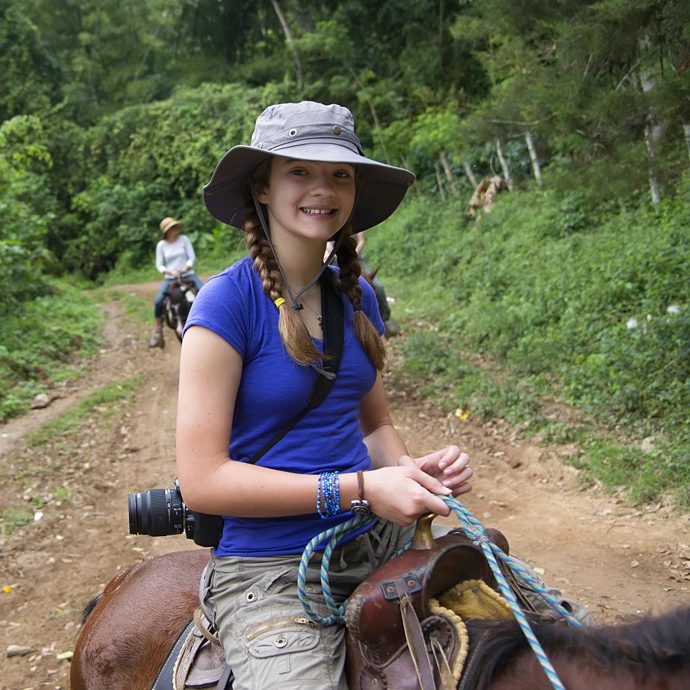 A Girl Riding A Horse On A Trail, Finca El Cisne, Honduras