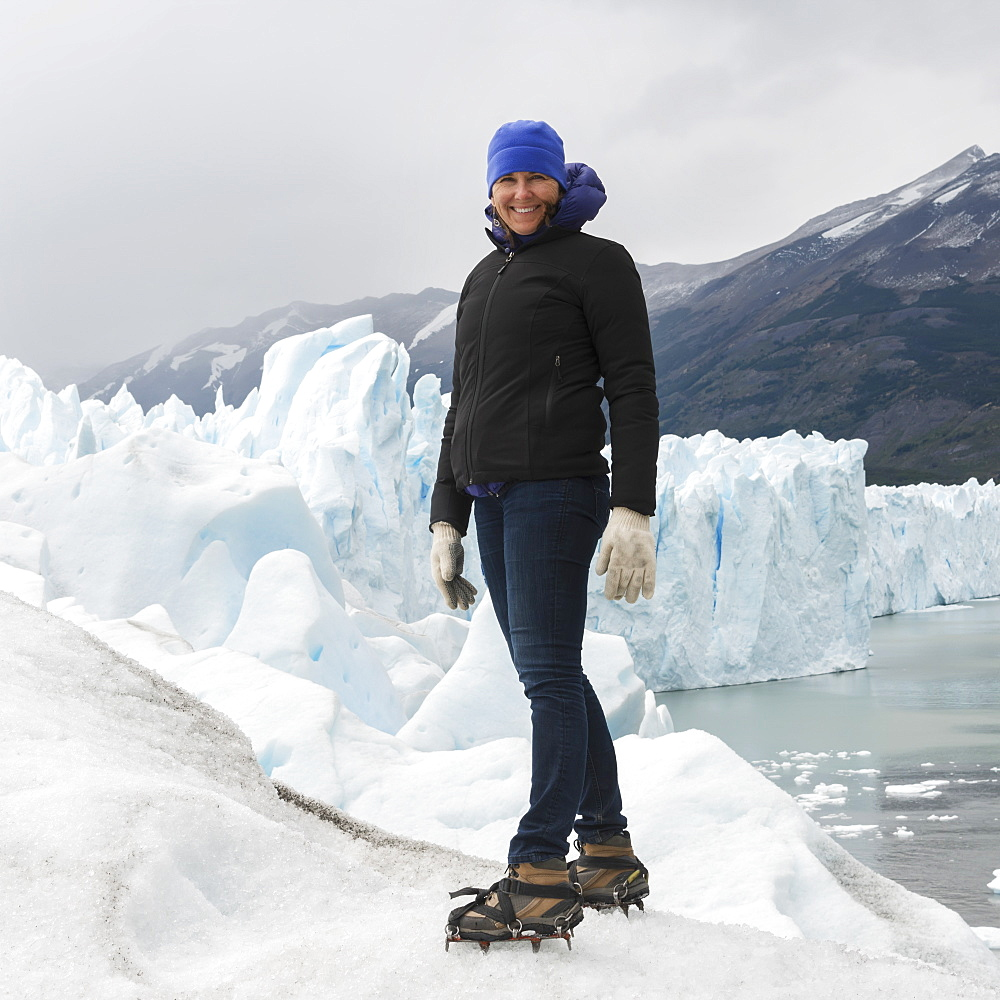 A Woman With Crampon Spikes On Her Hiking Boots On Moreno Glacier, Los Glaciares National Park, Santa Cruz Province, Argentina