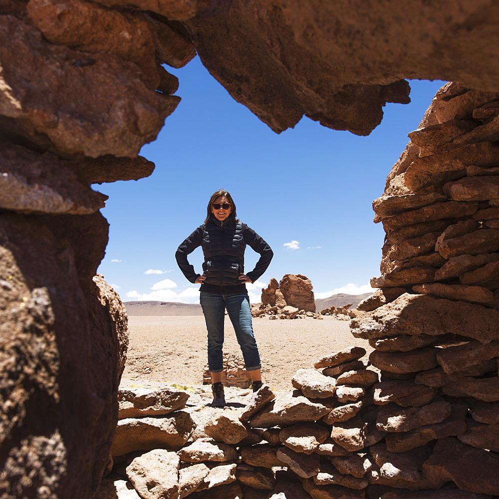 Portrait Of A Woman Standing In Salar De Atacama, San Pedro De Atacama, Antofagasta Region, Chile