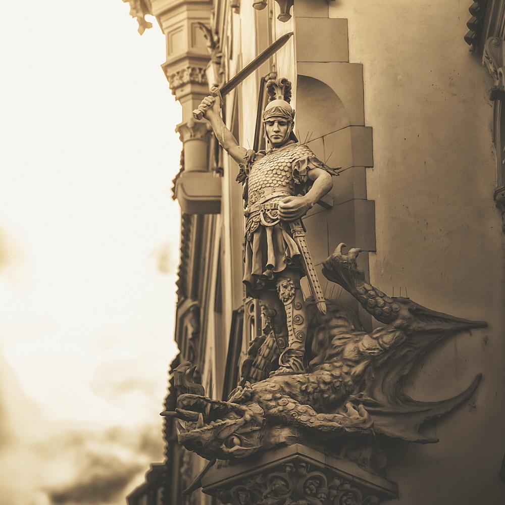 Statue On The Side Of A Building Of A Warrior Slaying A Dragon, Prague, Czech Republic