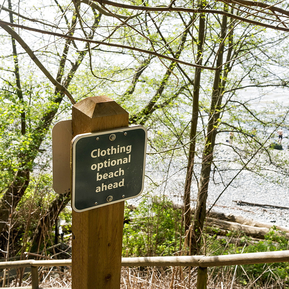 Sign On The Shore For A Beach Where Clothing Is Optional, Vancouver, British Columbia, Canada