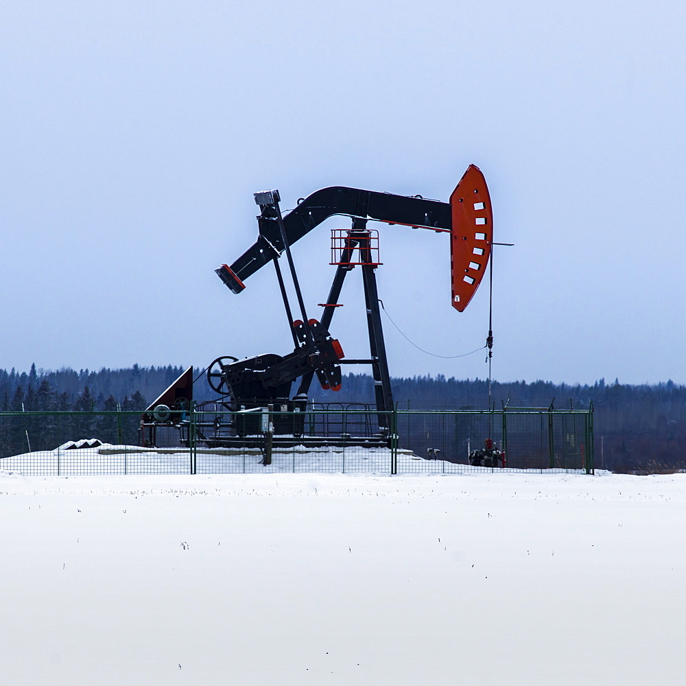 A Pumpjack In A Field Covered In Snow, Alberta, Canada