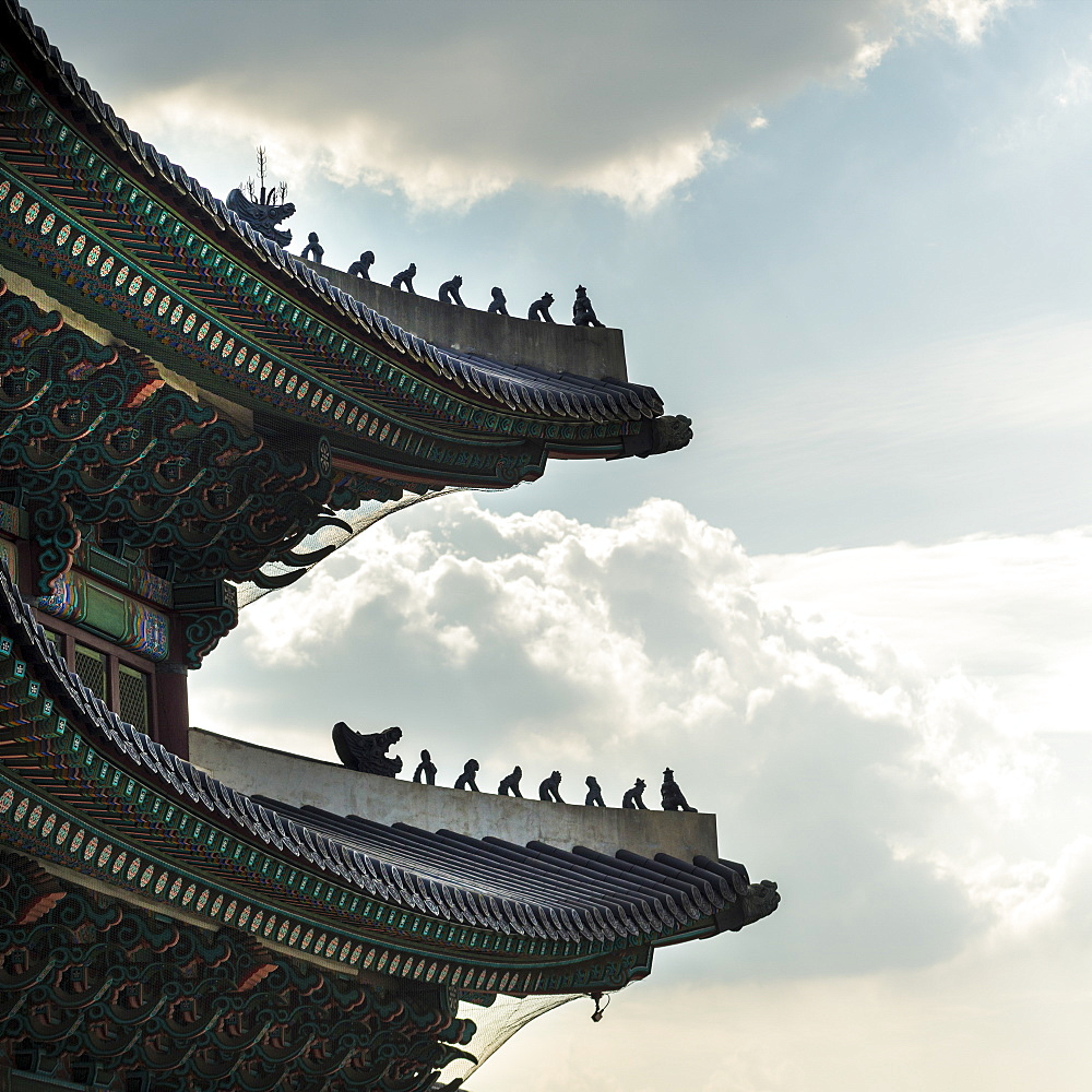 Detailed Roofline Of Gyeongbokgung Palace Against A Blue Sky With Cloud, Seoul, South Korea - 1116-46362