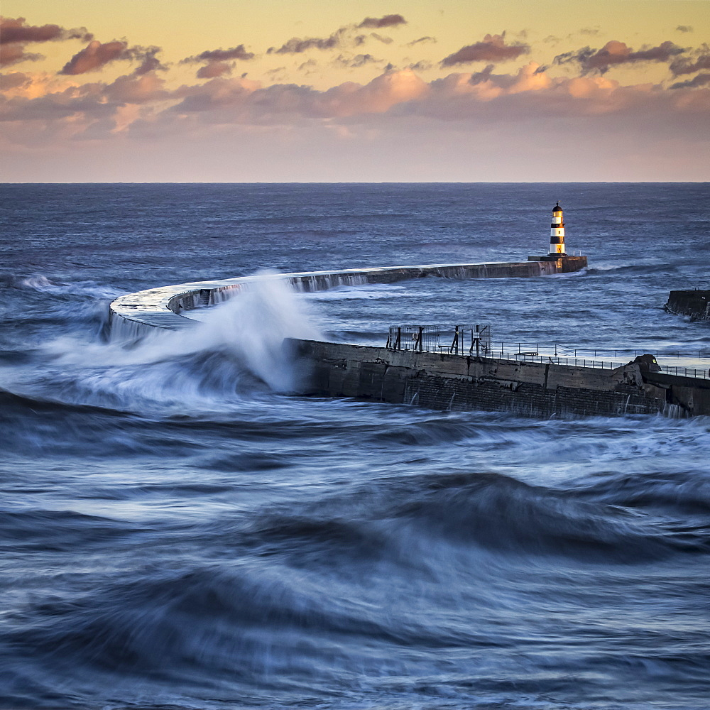 Waves Splashing On The Pier With A Glowing Sky At Sunset, Seaham, County Durham, England