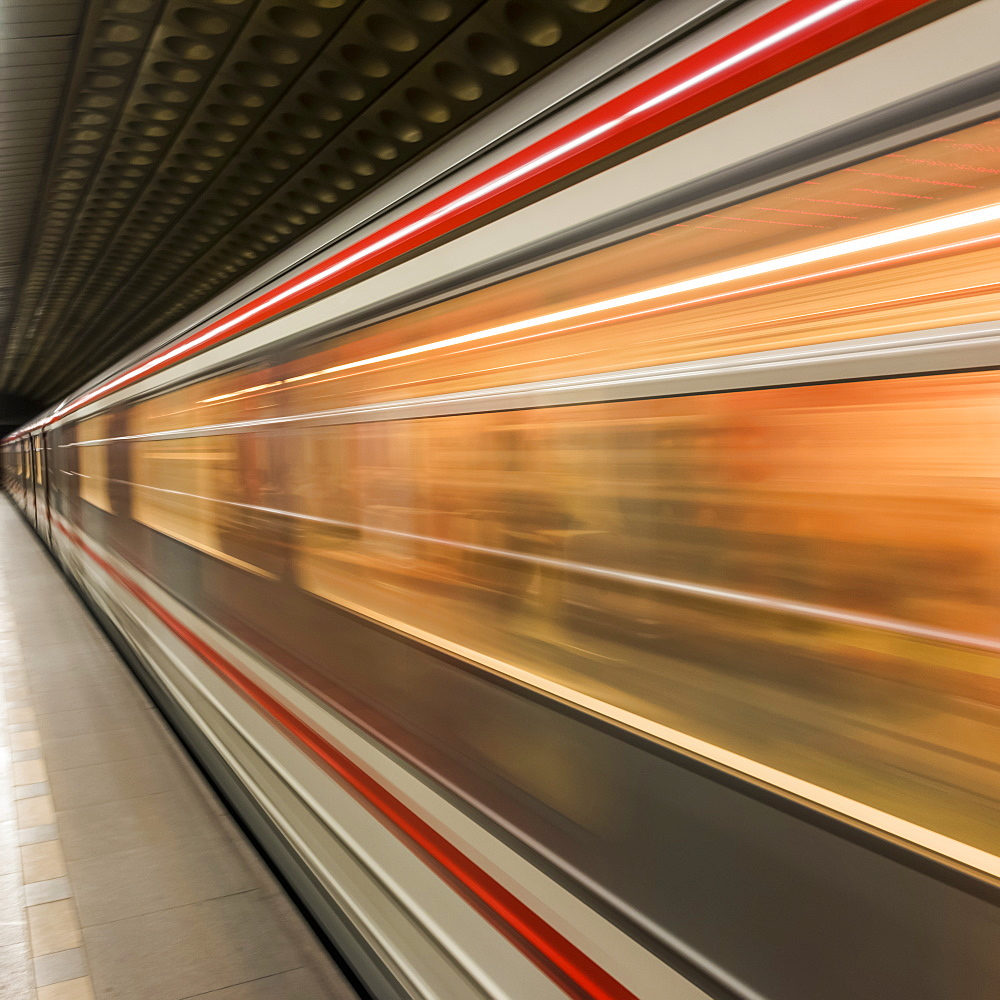 Motion Blur Of The Side Of A Train Passing Through A Station, Prague, Czech Republic