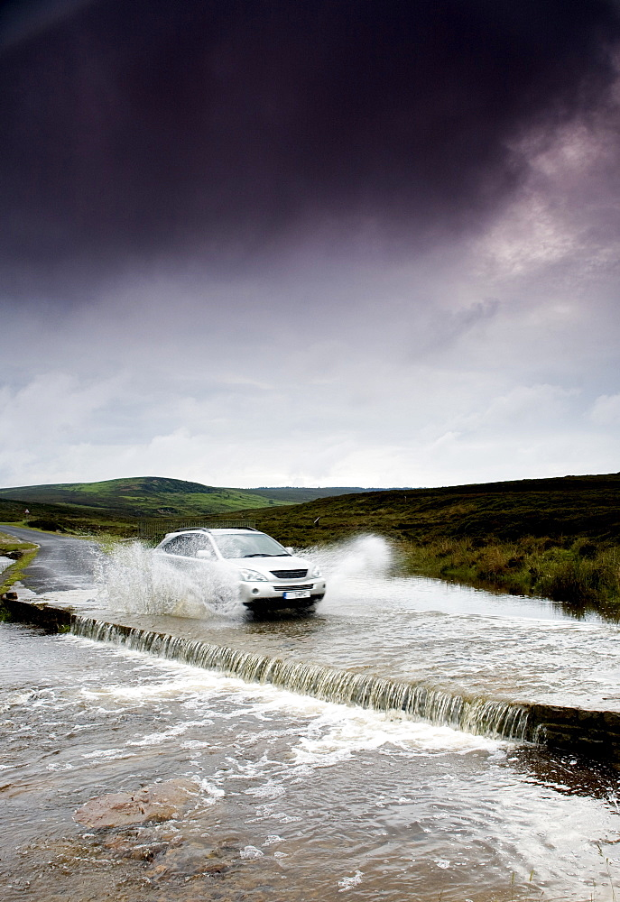Car Driving Down Flooded Road, Yorkshire, England