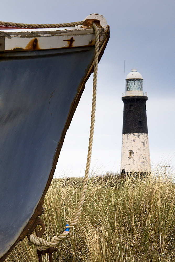 Abandoned Boat And Lighthouse, Humberside, England