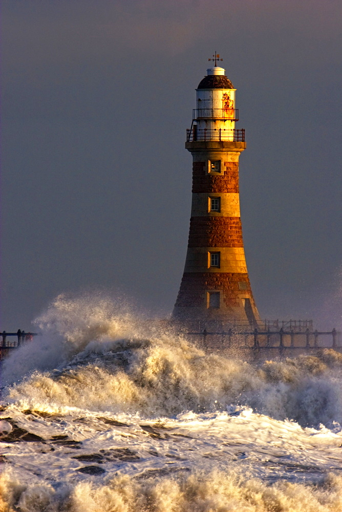 Waves Crashing Against A Lighthouse, Tyne And Wear, England