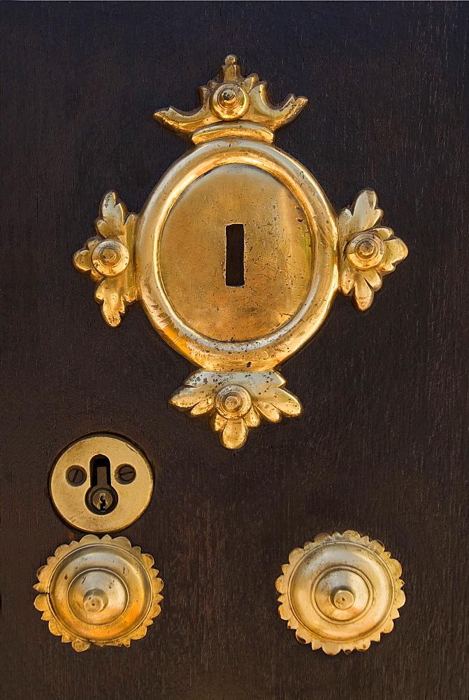 Brass Key Plates On Wooden Door