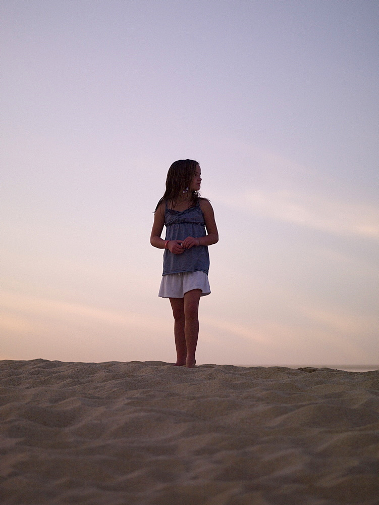 Girl Standing On The Beach