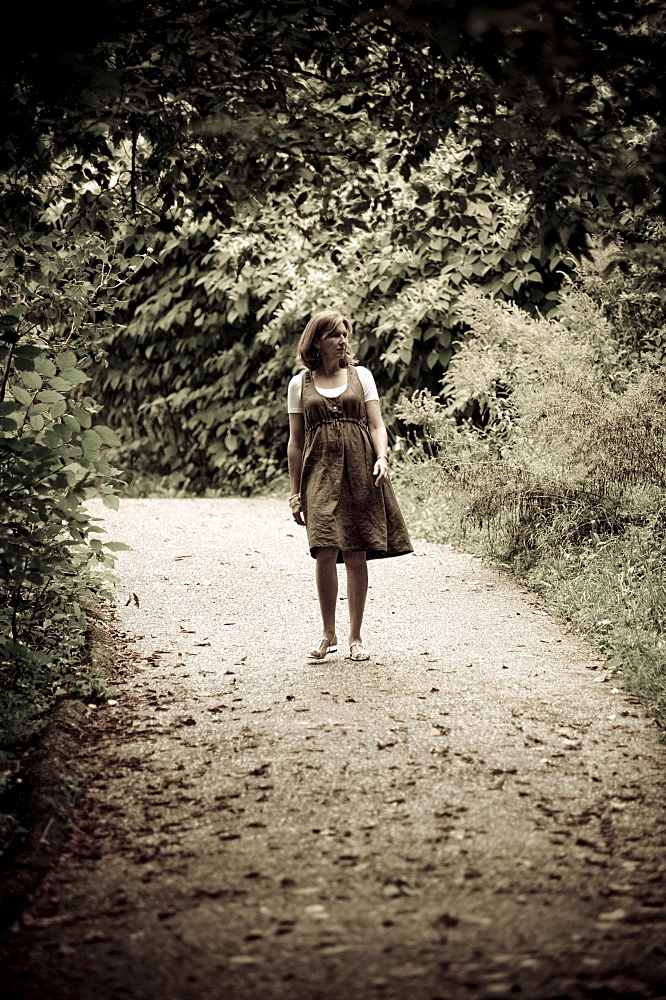 Woman On A Forest Path