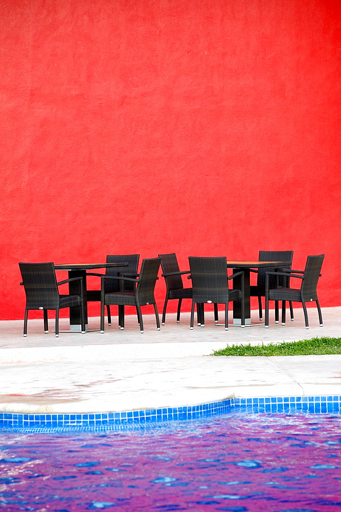 Puerto Vallarta, Mexico, Chairs And Tables By A Pool