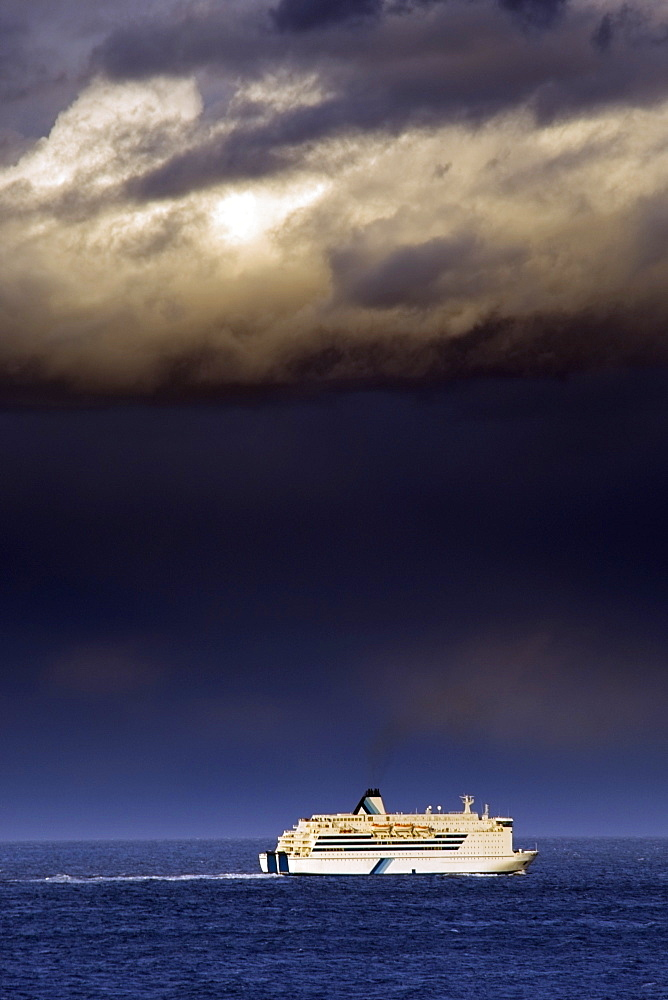 Cruise Ship Under A Dark Cloud