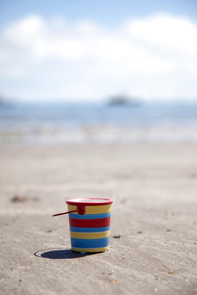 Sand Bucket On Beach, Boulmer Beach, Northumberland, England