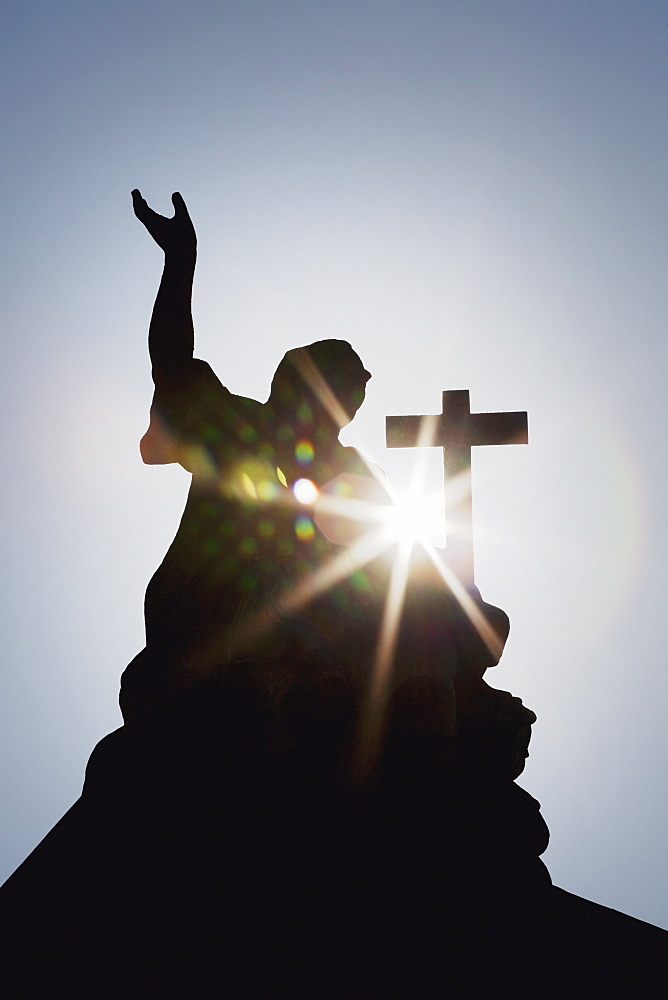 Silhouette Of A Statue And Cross With A Sun Burst, Strasbourg, France