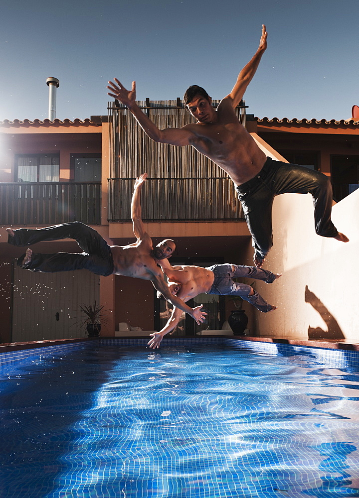 Three Men Jumping Into A Pool Wearing Their Pants, Tarifa, Cadiz, Andalusia, Spain - 1116-41629
