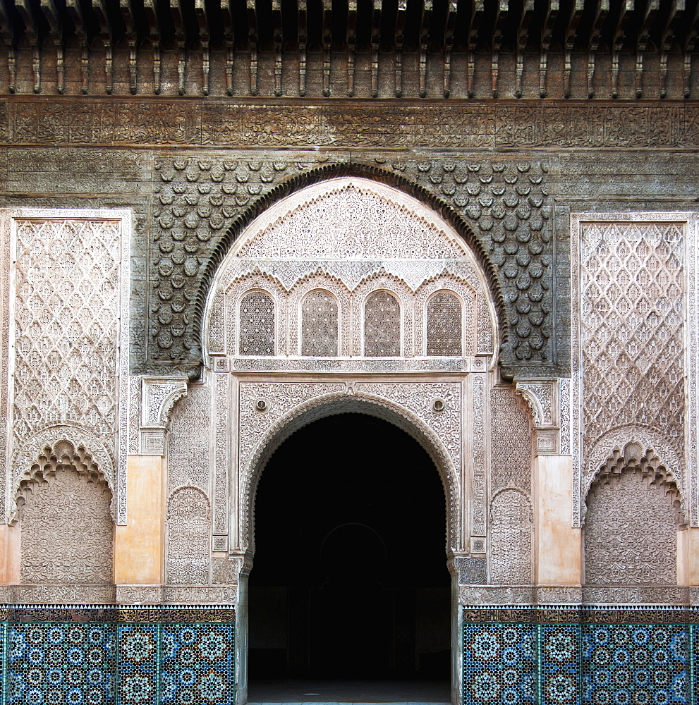An arched doorway on a building with ornate facade and colourful tile - 1116-41656
