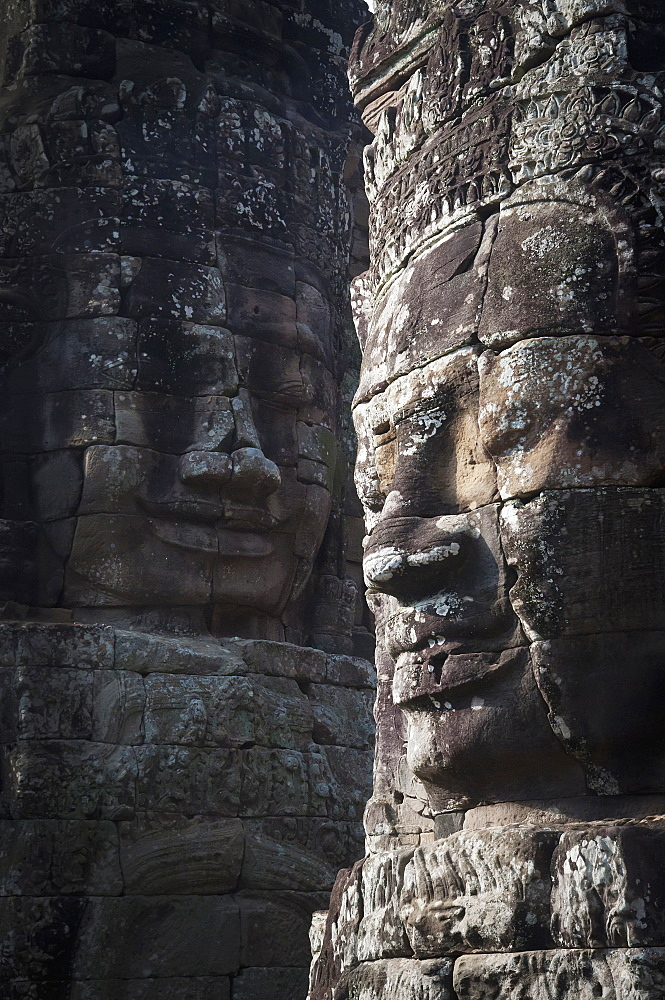 Face sculptures on stone walls at angkor wat, Cambodia