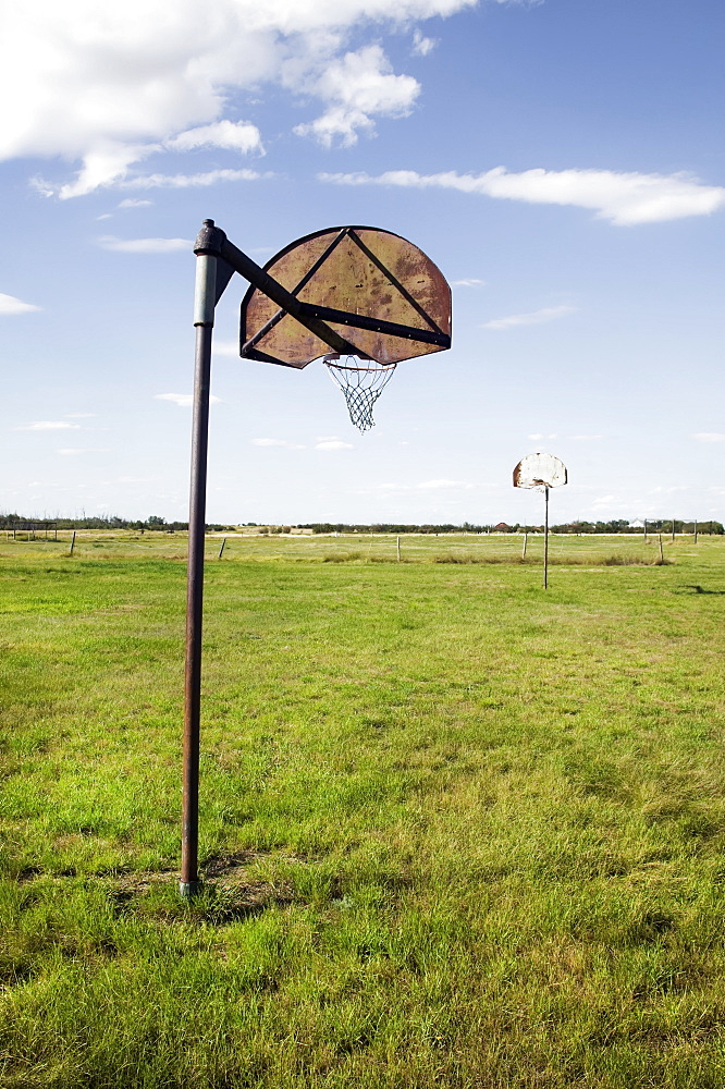 Basketball nets in a grass field, Saskatchewan canada