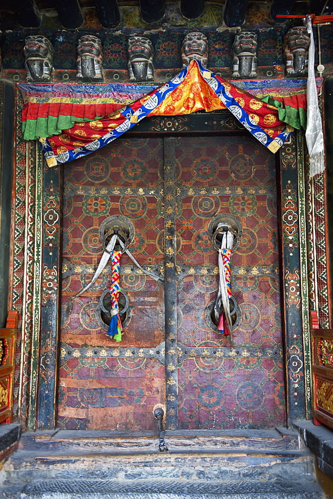 Ornate colourful doors at jokhang temple, Lhasa xizang china