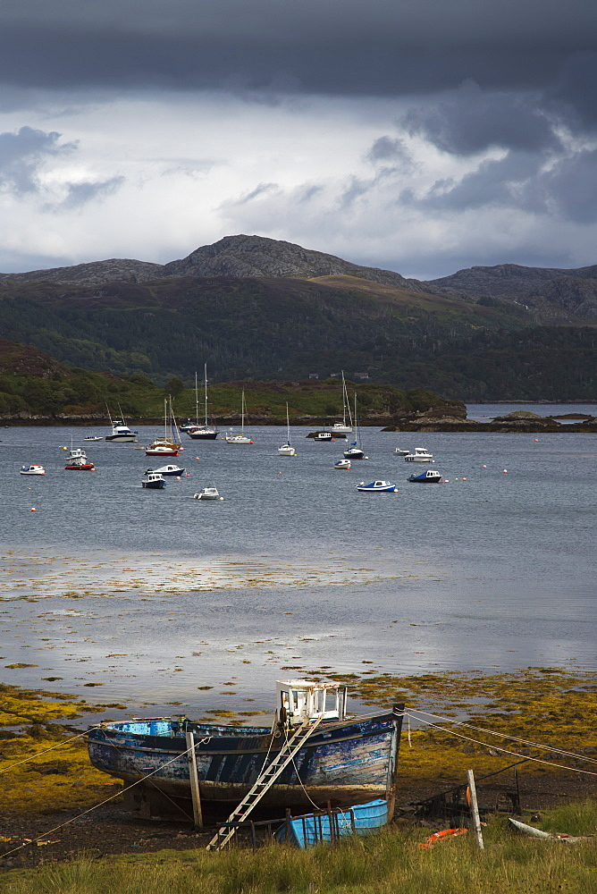 Boats mooring in the harbour under storm clouds, Kenmore wester ross scotland