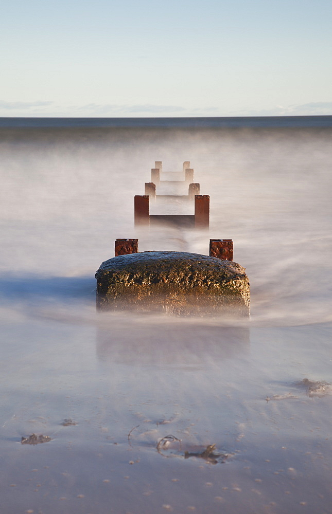 Concrete And Wooden Posts Immersed In Water And Mist, Northumberland, England