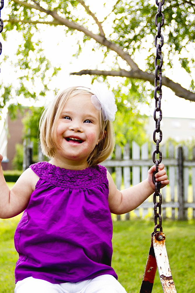 Young Girl With Down Syndrome On A Swing, Three Hills, Alberta, Canada - 1116-42042