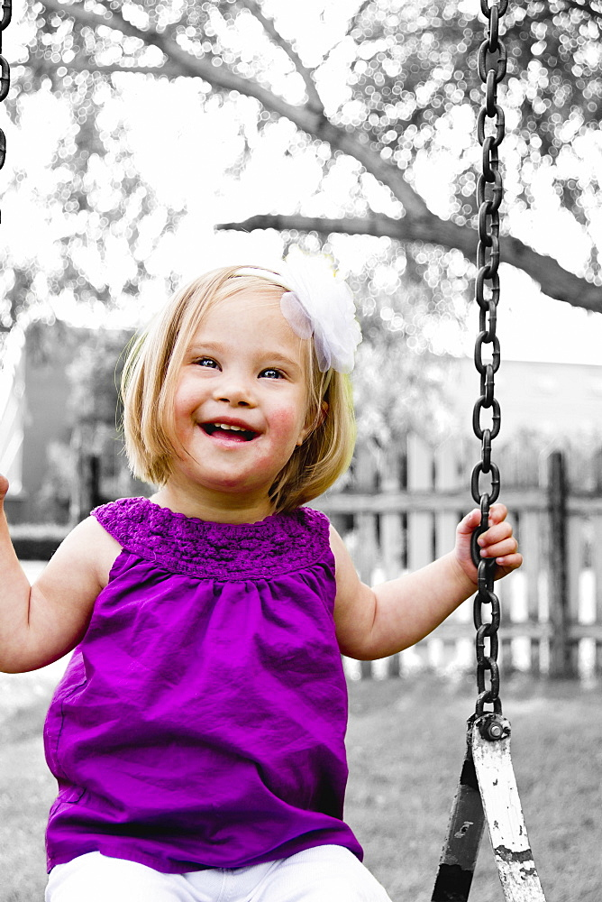 Young Girl With Down Syndrome On A Swing, Three Hills, Alberta, Canada - 1116-42042B