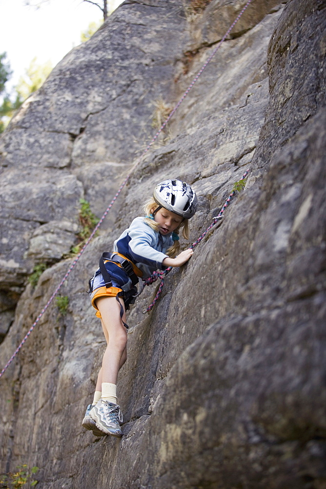Young Girl (Age 7) Climbing On Granite Cliff At Stone Hills Near Rexford, Montana, Usa - 1116-42070