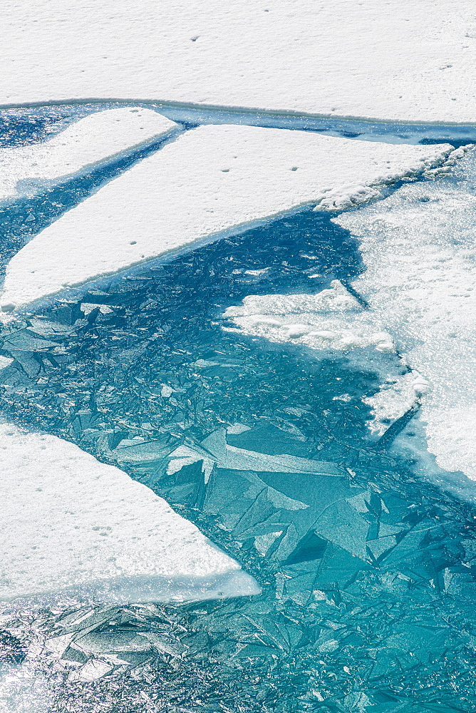 Ice Breaking Apart On The Surface Of Portage Lake In Springtime With Ice Crystals In The Water, Chugach National Forest, Portage, Alaska, United States Of America