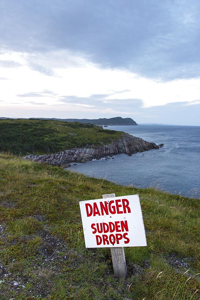 A Sign Warning A Danger And Sudden Drops Along The Atlantic Coastline, Calvert, Newfoundland And Labrador, Canada