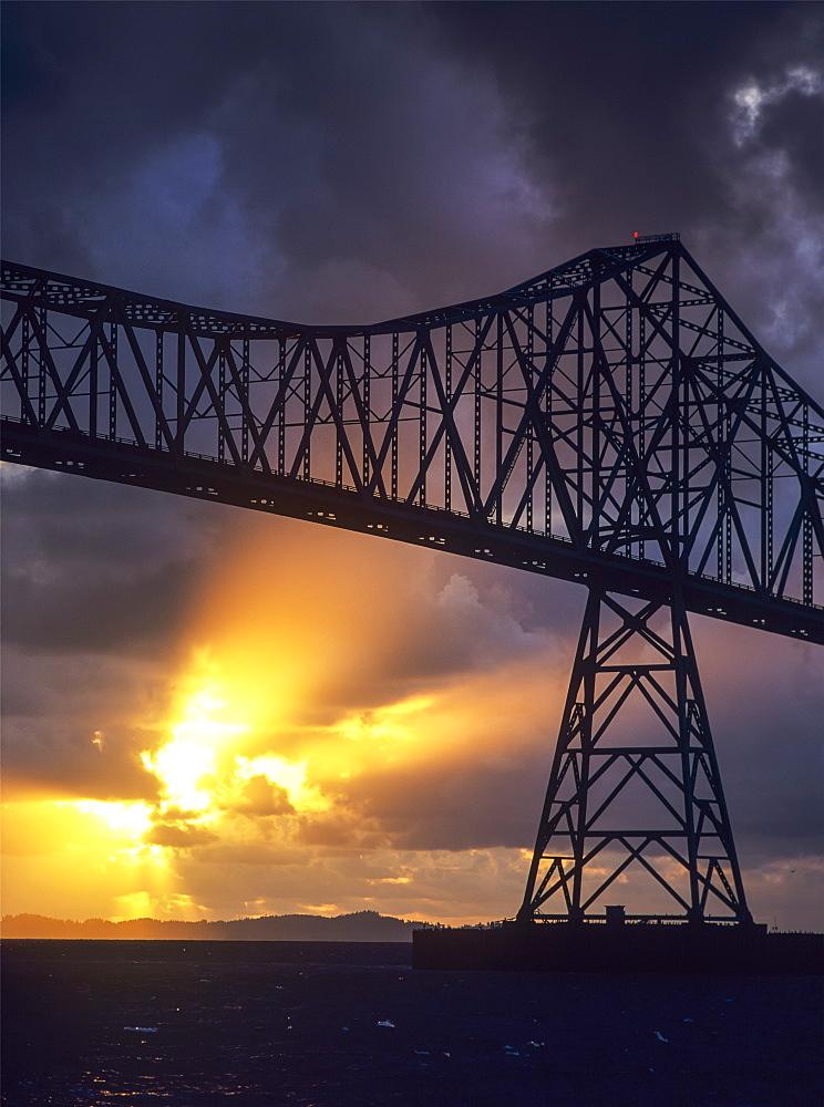 The Sun Sets Below The Astoria-Megler Bridge, Astoria, Oregon, United States Of America