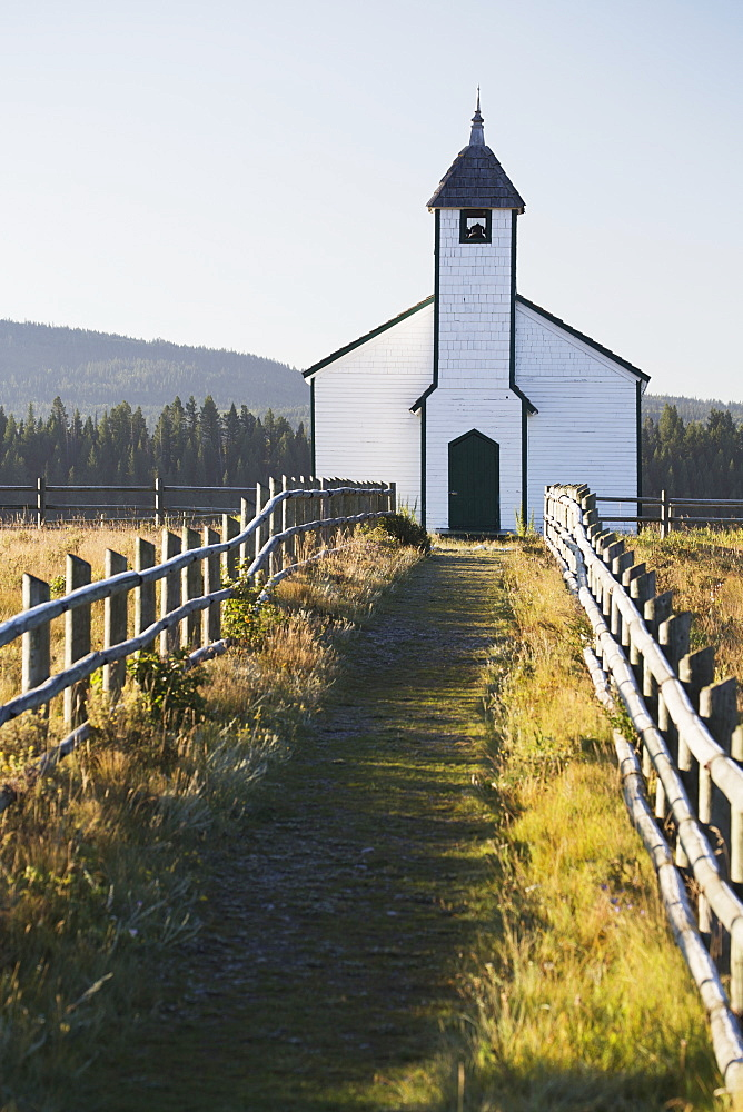 Old Wooden Church In Foothills With Wooden Fence And Blue Sky, Cochrane, Alberta, Canada