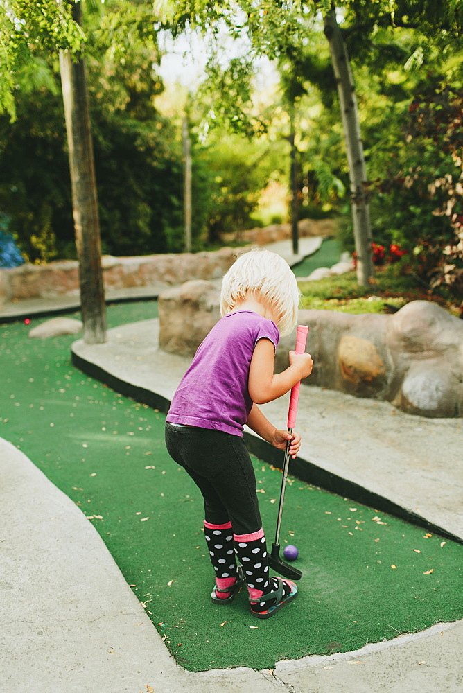 A Young Girl Playing Miniature Golf, Peachland, British Columbia, Canada
