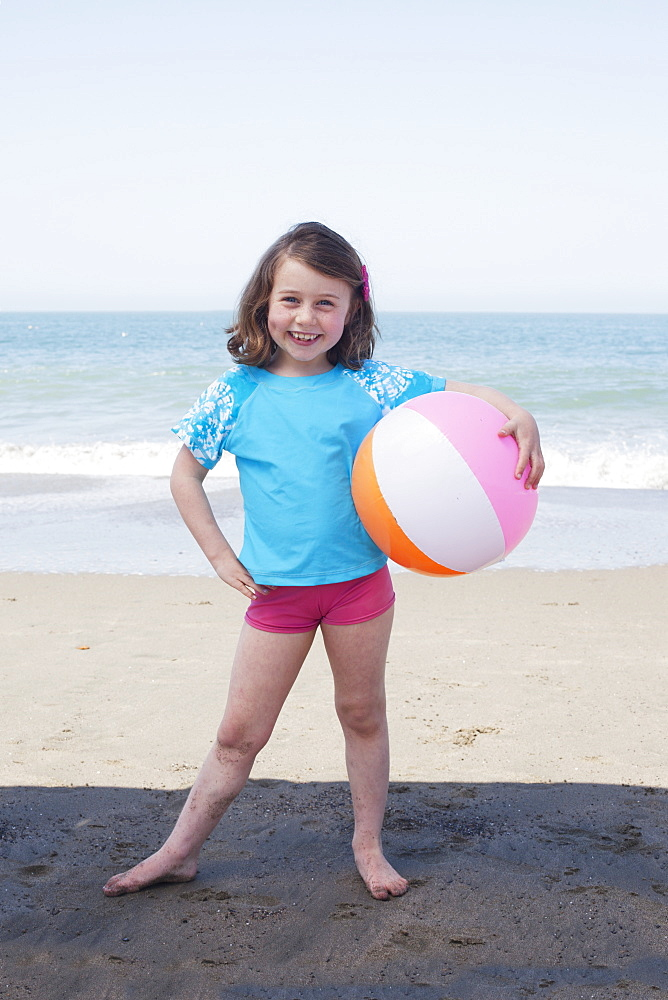 Young Girl With A Beach Ball On The Beach, San Francisco, California, United States Of America
