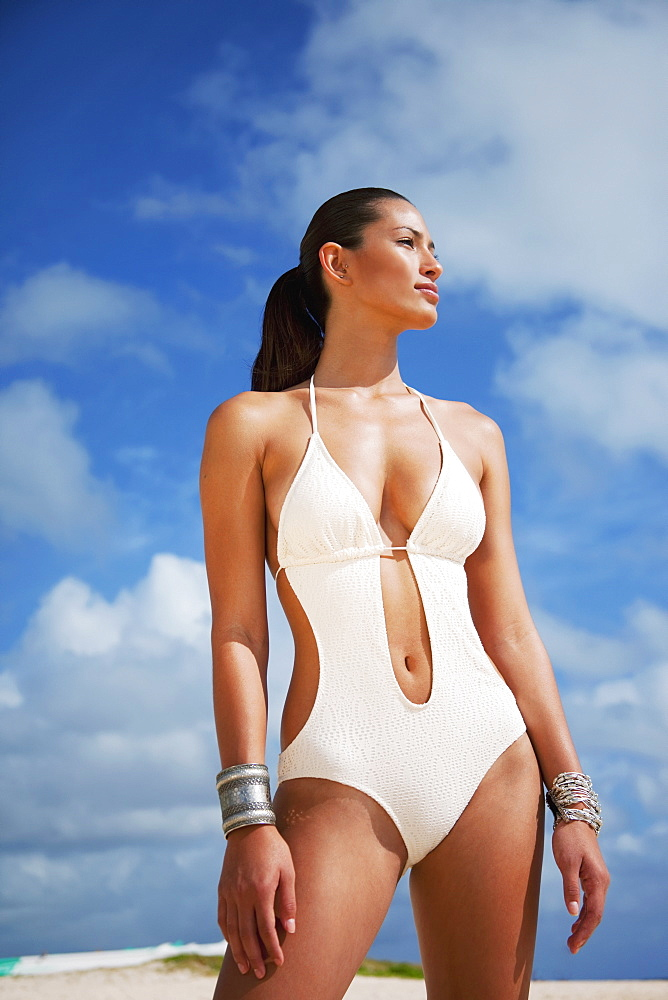 A Woman Posing In A Sexy White Bathing Suit, Oahu, Hawaii, United States Of America